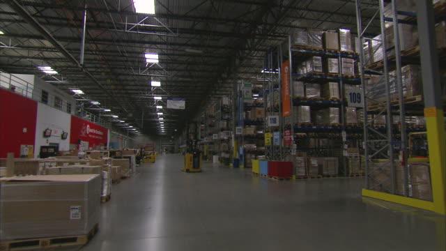 WS POV Forklift passing through warehouse / LeBec, CA, United States