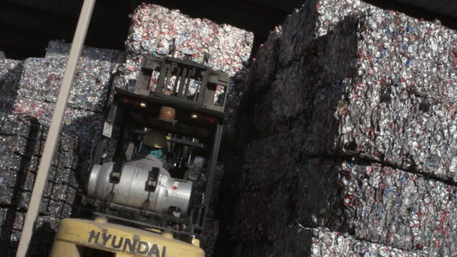 ms canted forklift picking up bundled aluminum cans at recycling centre, dallas, texas, usa - aluminium stock videos & royalty-free footage