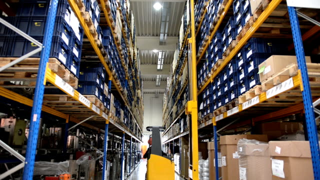 forklift truck in a distribution warehouse - forklift truck stock videos and b-roll footage