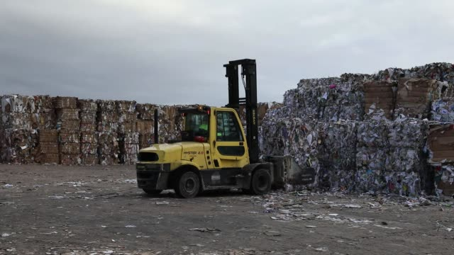 a forklift truck manoeuvers bales of recycled cardboard at the townsend hook paper mill operated by smurfit kappa group plc near maidstone uk on... - paper mill stock videos & royalty-free footage