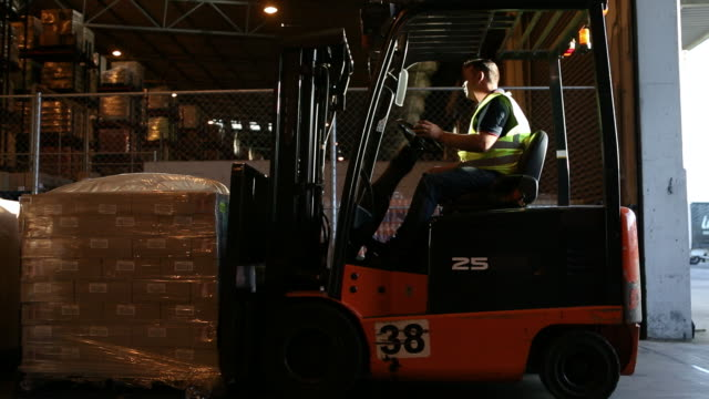 forklift truck operator in a food distribution warehouse - loading stock videos & royalty-free footage