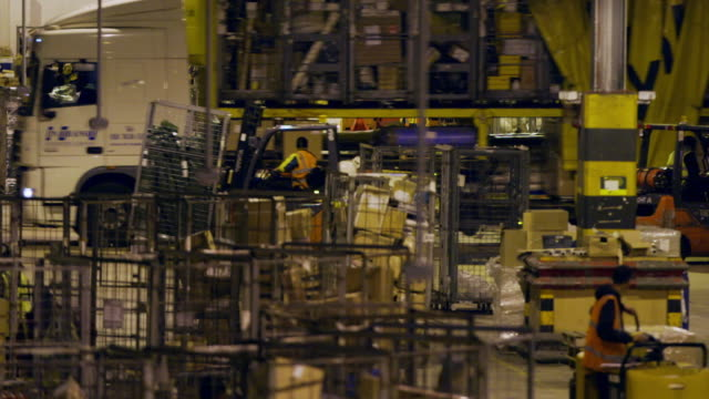 forklifts load trucks at a distribution warehouse - cardboard box stock videos & royalty-free footage