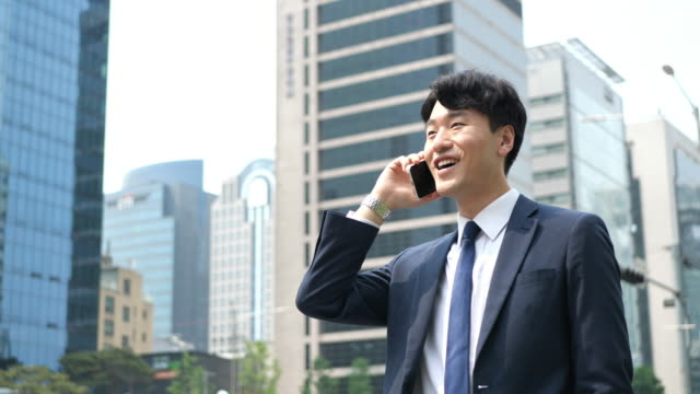 formal korean businessman using phone for communication with business partners - correspondence stock videos & royalty-free footage