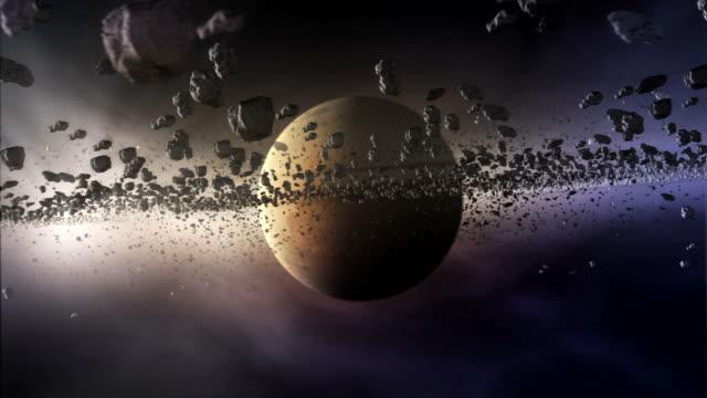 formation of a ring around an extrasolar planet (artists impression) - 小惑星点の映像素材/bロール