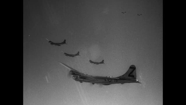 formation of boeing b29 superfortress heavy bomber aircraft in flight flying in sky / vs pit crew male navigator looking over map another male pilot... - schlacht um iwojima stock-videos und b-roll-filmmaterial