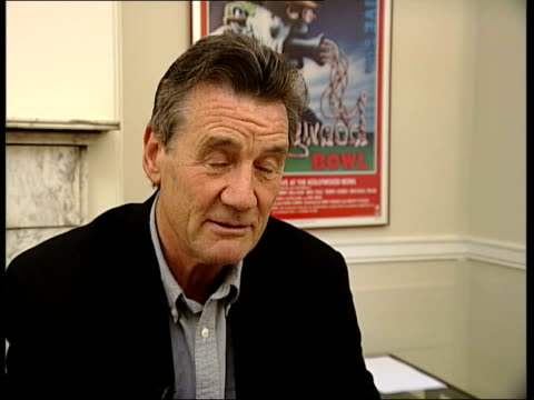 former beatle george harrison: death announced; itn london int michael palin interview sot - he shied away from big, grand gestures and big occasions - マイケル パリン点の映像素材/bロール