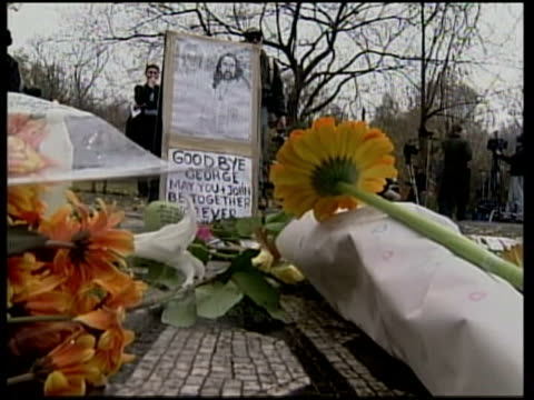 death announced itn usa new york people gathered at memorial to john lennon to lay flowers flowers and messages left at memorial man playing guitar - john lennon stock videos & royalty-free footage