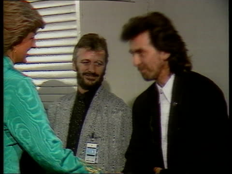 former beatle george harrison: death announced; lib england: london: harrison being presented to diana, princess of wales - george harrison stock videos & royalty-free footage