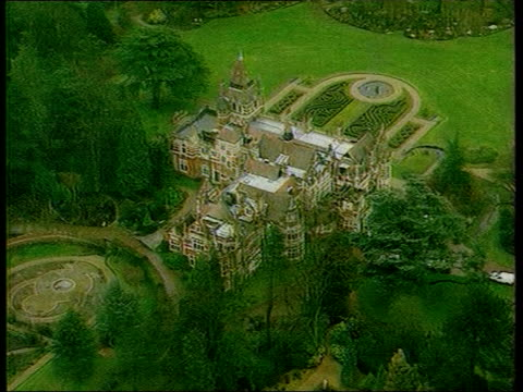 former beatle george harrison: death announced; lib england: oxfordshire: ext air view mansion where harrison lived and was attacked by an intruder - george harrison stock videos & royalty-free footage