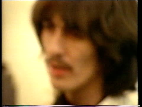 former beatle george harrison: death announced; lib ???: harrison smoking cigarette - george harrison stock videos & royalty-free footage