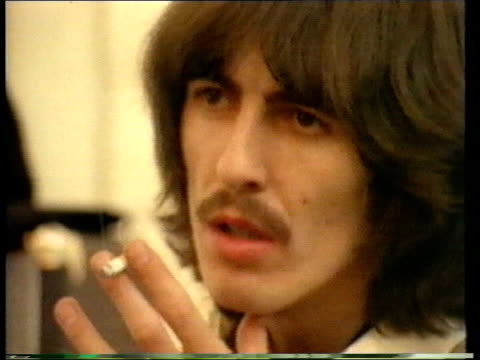 former beatle george harrison: death announced; lib ???: int harrison smoking cigarette - george harrison stock videos & royalty-free footage