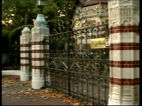 former beatle george harrison: death announced; lib oxfordshire: ext gates to mansion of harrison where he was attacked by an intruder - oxfordshire stock videos & royalty-free footage