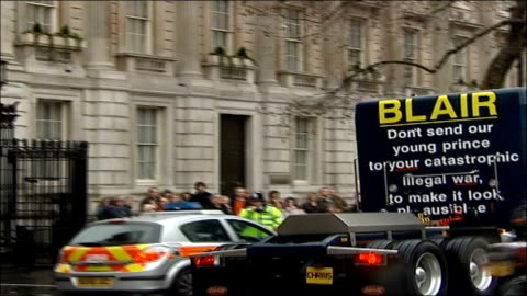 former boxer chris eubank arrested after anti-iraq war protest in london; england: london: whitehall: ext truck driven by chris eubank with 'blair... - chris eubank sr. stock videos & royalty-free footage