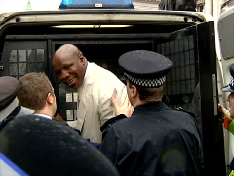 former boxer chris eubank arrested after anti-iraq war protest in london; england: london: ext chris eubank led along by two policeman eubank into... - chris eubank sr. stock videos & royalty-free footage
