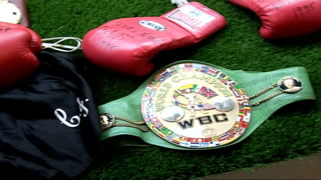 former boxer nigel benn auctions off title belts england london photography** former boxer nigel benn posing for photocall with boxing title belt... - boxer shorts stock videos and b-roll footage