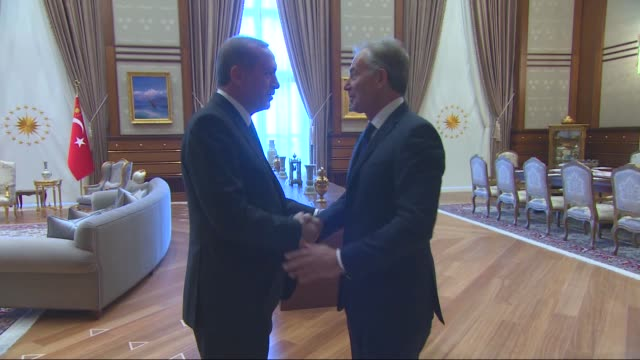 stockvideo's en b-roll-footage met former british prime minister tony blair is welcomed by turkish president recep tayyip erdogan before their meeting at presidential complex in ankara... - minister president