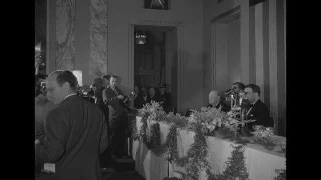 ls former british prime minister winston churchill seated at table with new york governor thomas e dewey and grover whalen chairman of the mayor's... - 市庁舎点の映像素材/bロール
