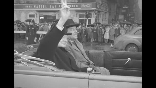 vs former british prime minister winston churchill waves his hat from a convertible automobile driving on a wet brick street in manhattan / seated... - 1946 stock-videos und b-roll-filmmaterial