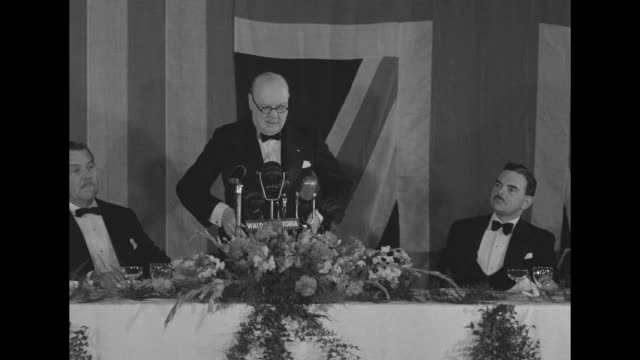 "former british prime minister winston churchill, wearing eyeglasses, speaks into microphones with ""waldorf astoria"" plaque and flowers in front of... - chair stock videos & royalty-free footage"