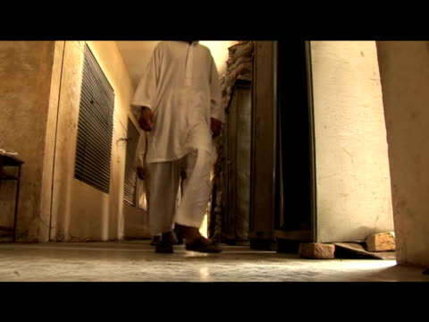 former child taliban soldiers walk along corridor step through doorway 3 august 2009 - pakistan stock videos & royalty-free footage
