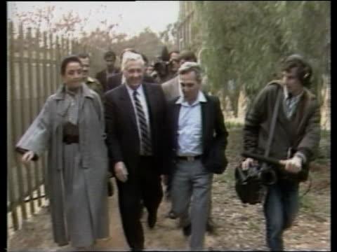 vidéos et rushes de former defence minister ariel sharon leaves office; sharon shaking with generalscrowdsharon walks towardsknesset int knesset zoom member... - précédent