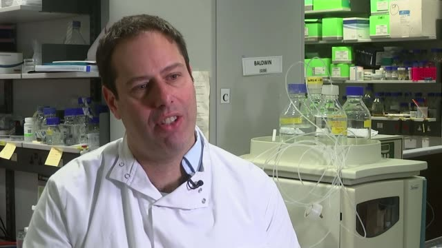 former dentist survived four different cancers due to extraordinary blood cells aiming to help others england int scientists in lab **davis interview... - awe stock videos & royalty-free footage