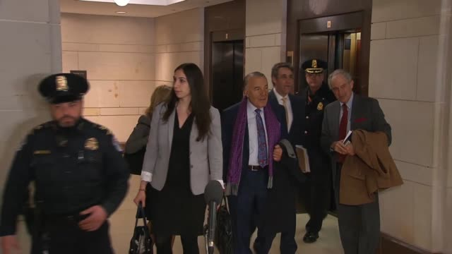 former donald trump attorney michael cohen is escorted by us capitol police and personal attorney lanny davis out of an elevator to a classified... - former stock videos and b-roll footage
