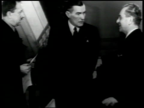 stockvideo's en b-roll-footage met former embassy of czechoslovakia cars passing fg minister vladimir hurban talking w/ two men ext polish embassy jerzy potocki aides government in - 1940 1949