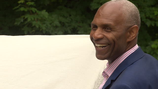 former england centre-forward luther blissett holding up an england flag - symbol stock videos & royalty-free footage