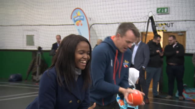 former england cricketer graeme swann and his strictly come dancing dance partner oti mabuse training and dancing with children in leicester - ストリクトリーカムダンシング点の映像素材/bロール