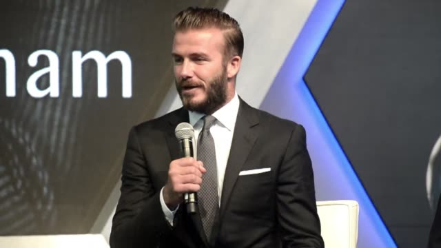 former england footballer david beckham was in singapore saturday to sign a pair of boots for a celebrity charity auction and to conduct a sports... - beneficiary stock videos & royalty-free footage
