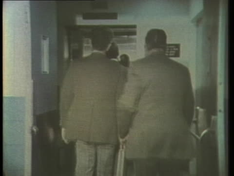 former executives of associated milk producers inc harold nelson and david parr leave a washington dccourtroom after being sentenced to four months... - crime or recreational drug or prison or legal trial stock-videos und b-roll-filmmaterial