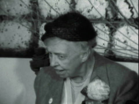 former first lady eleanor roosevelt seated at table for press conference / mrs. roosevelt presents her assessment of the eisenhower administration's... - only mature women stock videos & royalty-free footage