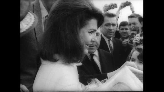 former first lady jackie kennedy accompanied by ambassador angier biddle duke steps off plane in seville, spain for the annual feria debutant ball /... - jackie kennedy stock videos & royalty-free footage