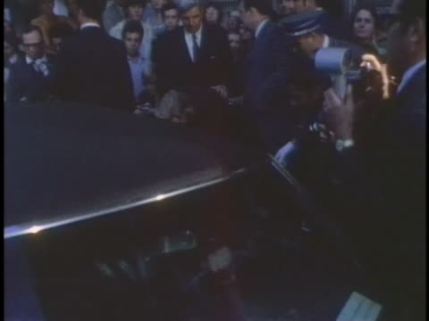 former first lady jacqueline kennedy walks through a crowd of journalists in the days before her marriage to aristotle onassis. - jackie kennedy stock videos & royalty-free footage