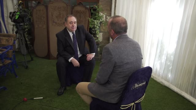 former first minister of scotland alex salmond denies harassment allegations scotland int alex salmond and reporter along together and sitting down... - alex salmond stock videos & royalty-free footage