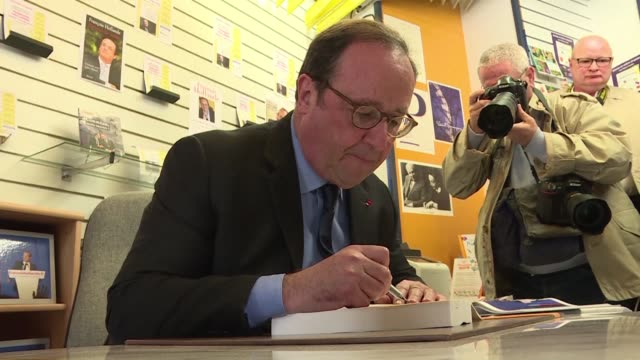 former french president françois hollande signs his new book for the first time les leçons du pouvoir in his electoral home of tulle - tulle stock videos and b-roll footage