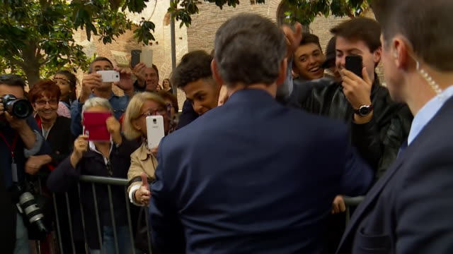 Former French President Nicolas Sarkozy greeting supporters