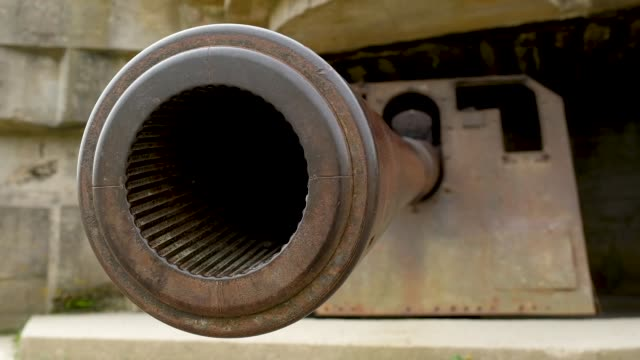 former german artillery gun that points towards the english channel from a world war ii-era bunker on may 3, 2019 at longues-sur-mer, france. june 6... - cannon stock videos & royalty-free footage