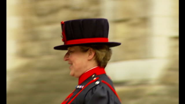 stockvideo's en b-roll-footage met former governor of tower of london alleges that beefeaters were bullies r03090706 ext moira cameron along with colleague carrying ceremonial axe then... - yeomen warder