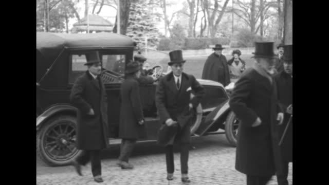 former greek prime minister eleftherios venizelos and entourage exit car / italian prime minister benito mussolini and entourage exit car / turkish... - benito mussolini stock videos & royalty-free footage