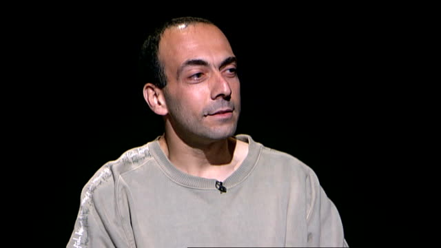 former guantanamo detainee bisher alrawi interview **itn bulletins must onscreen credit 'channel 4 news'** bisher alrawi interview sot 9/11 has... - channel 4 news stock videos and b-roll footage