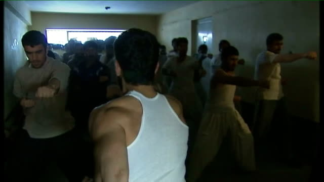 former guantanamo inmates held in kabul's 'block d' prison afghanistan kabul pulecharkhi prison int various shots prison inmates exercising in... - detainee stock videos & royalty-free footage