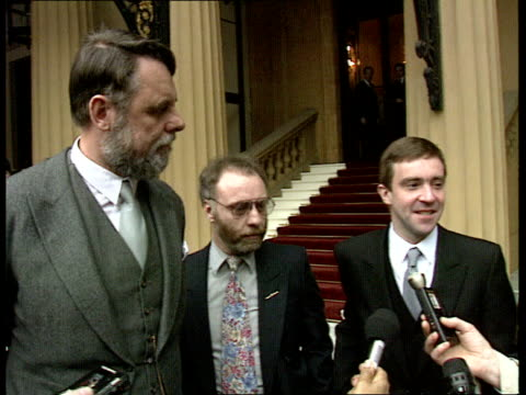 stockvideo's en b-roll-footage met former hostages england london buck palace ms john mccarthy terry waite amp brian keenan showing cbe's ms press taking pics ms terry waite speaking... - terry waite