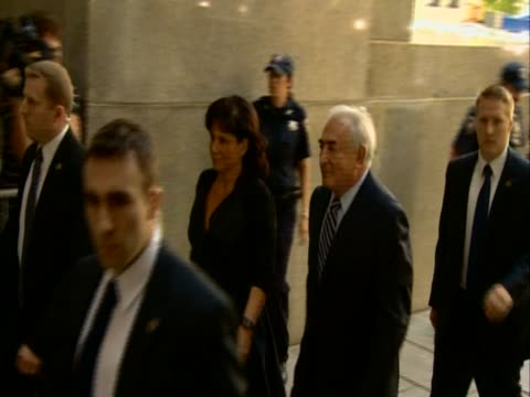 former imf director dominique strauss kahn and his wife anne sinclair arrive at court new york august 2011 - sinclair institute stock videos and b-roll footage