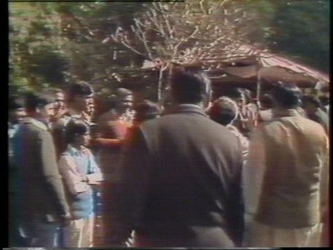 former indian prime minister indira gandhi walks among her supporters in new delhi. - (war or terrorism or election or government or illness or news event or speech or politics or politician or conflict or military or extreme weather or business or economy) and not usa stock videos & royalty-free footage