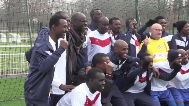 former international footballer lilian thuram takes part in a friendly football match in northern france with recently arrived refugees following the... - international match stock videos & royalty-free footage