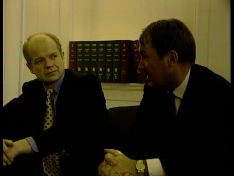 Former IRA terrorist found dead/punishment beatings ITN ENGLAND London Westminster CMS William Hague MP seated for photocall with Conservative...