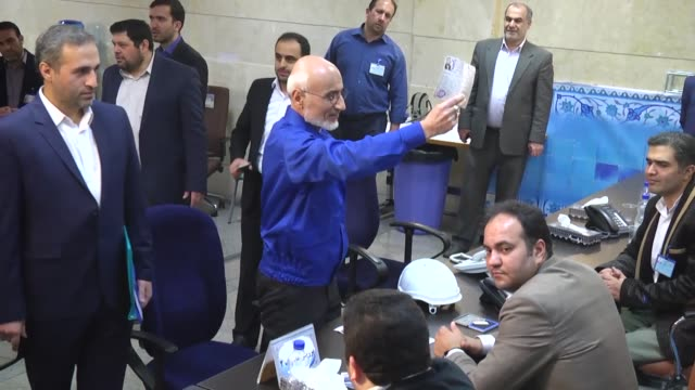 Former Iranian Culture Minister and conservative politician Mostafa MirSalim register and other Iranians register their candidacies at the Ministry...