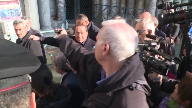 former italian prime minister and head of the centre right forza italia party silvio berlusconi visits venice wearing wellies to brave the acqua alta - alta stock videos & royalty-free footage